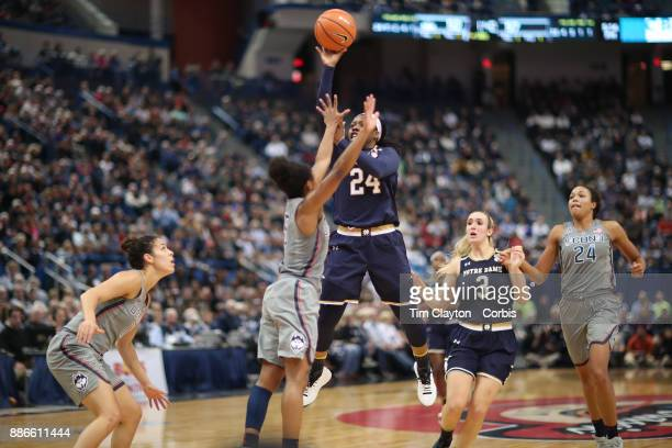 Arike Ogunbowale of the Notre Dame Fighting Irish shoots over Crystal Dangerfield of the Connecticut Huskies during the the UConn Huskies Vs Notre...