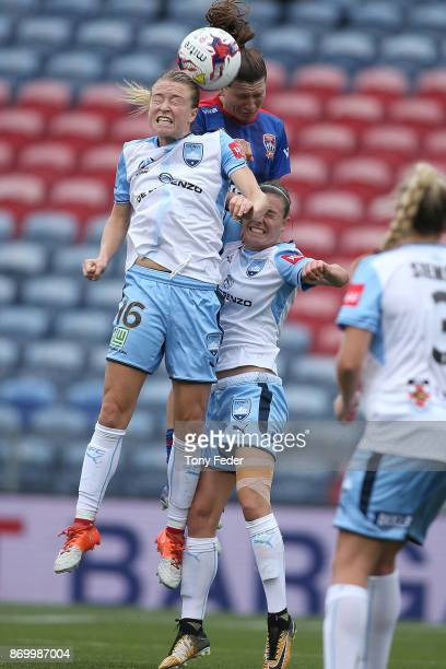 Arin Gilliland of the Jets and Emily Sonnett of Sydney FC contest a header during the round two WLeague match between the Newcastle Jets and Sydney...