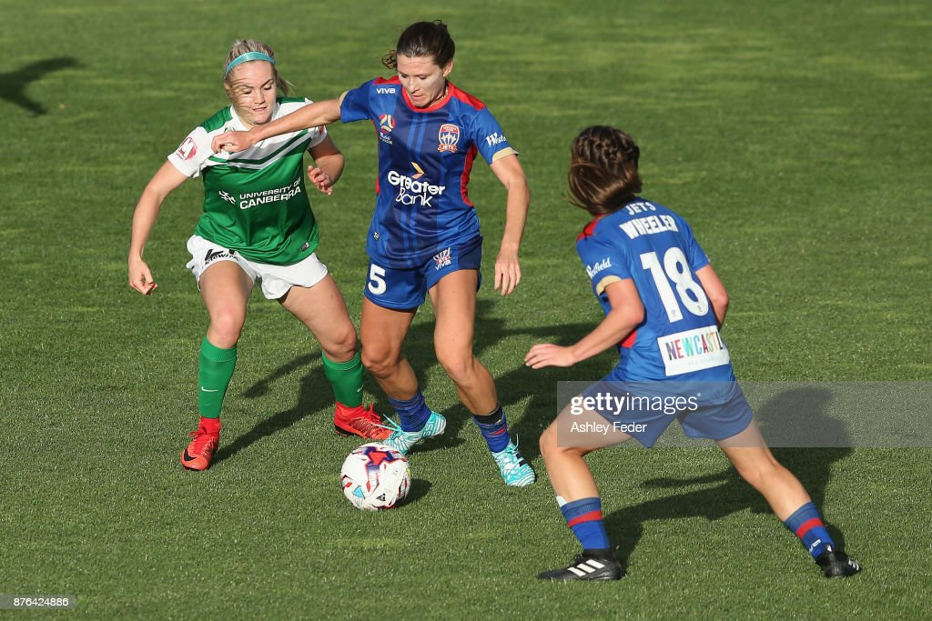 Arin Gilliland of the Jets contests the ball against Ellie Carpenter of Canberra United during the round four W-League match between Newcastle and Canberra on November 19, 2017 in Newcastle, Australia.