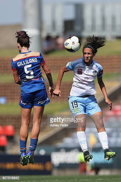 Arin Gilliland of the Jets contests the header against Leena Khamis of Sydney FC during the round five WLeague match between the Newcastle Jets and...