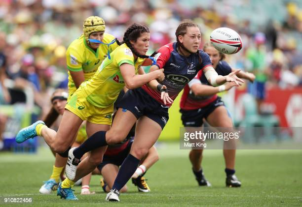 Arina Bystrova of Russia offloads the ball in a tackle from Charlotte Caslick of Australia in the Cup semi final match during day two of the 2018...