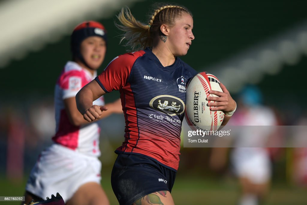 Arina Bystrova of Russia scores a try during the match between Russia and Japan on Day One of the Emirates Dubai Rugby Sevens - HSBC Sevens World Series at The Sevens Stadium on November 30, 2017 in Dubai, United Arab Emirates.