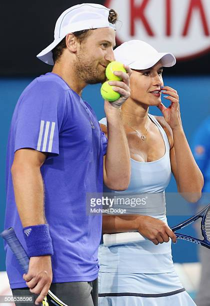 Arina Rodionova and Matt Reid of Australia play in their Round 1 mixed doubles match against Samantha Stosur and John Peers of Australia during day...