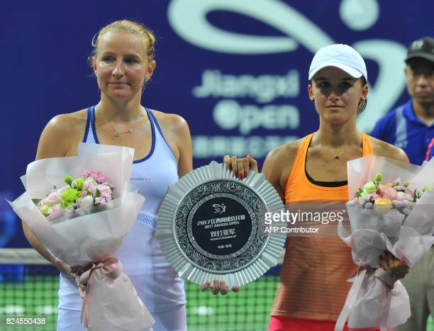 Arina Rodionova of Australia and Alla Kudryavtseva of Russia hold the runnersup trophy after losing the doubles final at the Jiangxi Open WTA tennis...