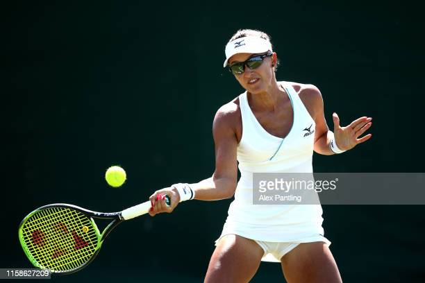 Arina Rodionova of Australia plays a forehand in her ladies singles match against Danielle Lao of The United States during qualifying prior to The...