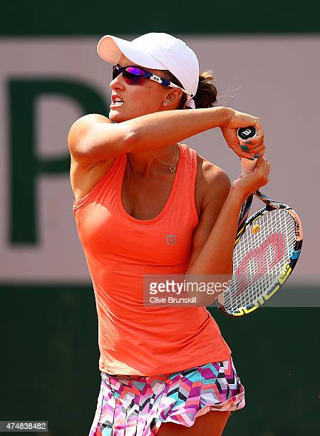 Arina Rodionova of Australia returns a shot next to her partner Anastasia Rodionova of Australia during their women's doubles match against Darija...