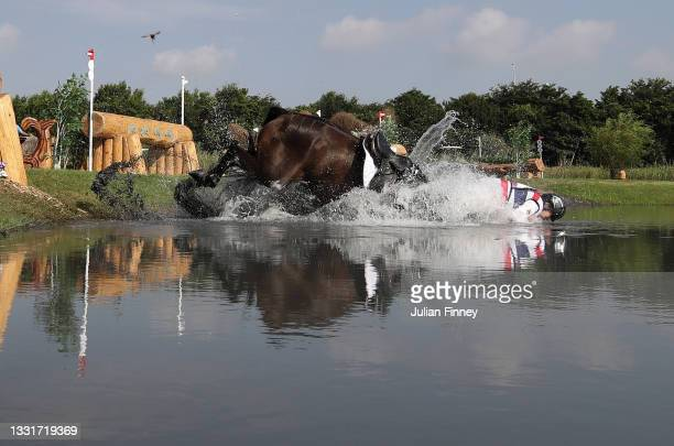 Arinadtha Chavatanont of Team Thailand riding Boleybawn Prince falls at the Sanctuary water jump on day nine of the Tokyo 2020 Olympic Games at Sea...