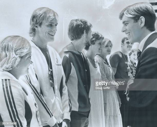 Aring a joke Prince Andrew laugh with two members of Canadian team divers Beverly Boys and Ken Armstrong both of Senneville Que during Prince's visit...