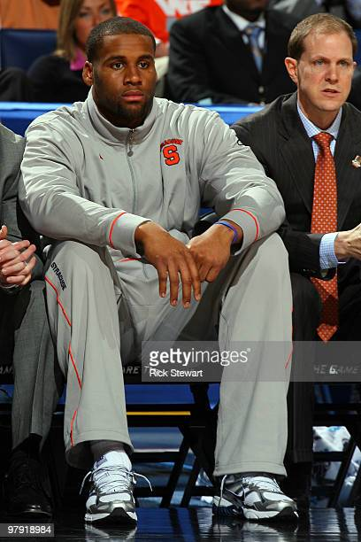 Arinze Onuaku of the Syracuse Orange looks on from the bench against the Gonzaga Bulldogs during the second round of the 2010 NCAA men's basketball...