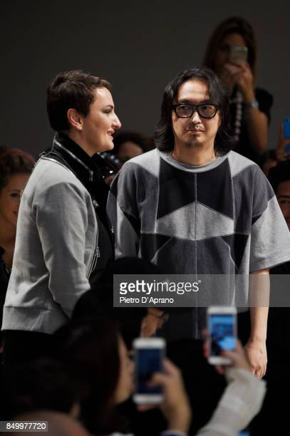 Arisa and Atsushi Nakashima acknowledge the audience at the Atsushi Nakashima show during Milan Fashion Week Spring/Summer 2018 on September 20 2017...