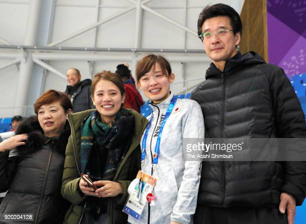 Arisa Go of Japan poses for photographs with her family after competing in the Speed Skating Ladies' 500m on day nine of the PyeongChang 2018 Winter...