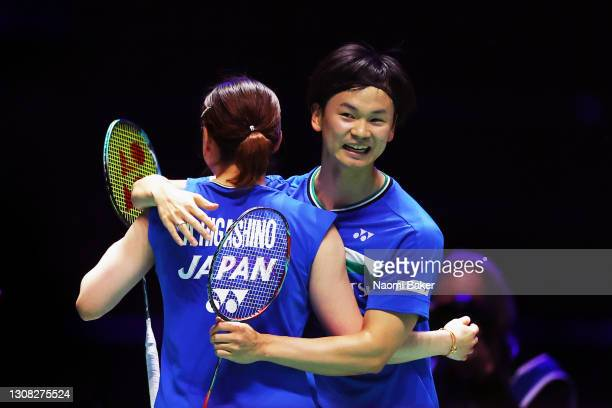Arisa Higashino and Yuta Watanabe of Japan celebrate match point after their victory in the mixed doubles final against Yuki Kaneko and Misaki...