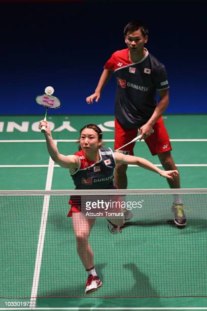 Arisa Higashino and Yuta Watanabe of Japan compete in the Mix Doubles quarter final match against Koharu Yonemoto and Takuro Hoki of Japan on day...