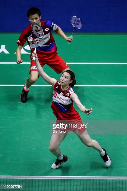 Arisa Higashino and Yuta Watanabe of Japan compete in the Mixed Doubles match against Savitree Amitrapai and Dechapol Puavaranukroh of Thailand...