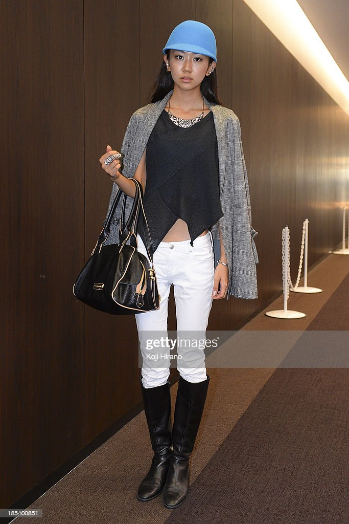 Arisa Ishiwata wears all vintage, and a bag by Steve Martin at Mercedes-Benz Fashion Week Tokyo Spring/Summer 2014 on October 16, 2013 in Tokyo, Japan.