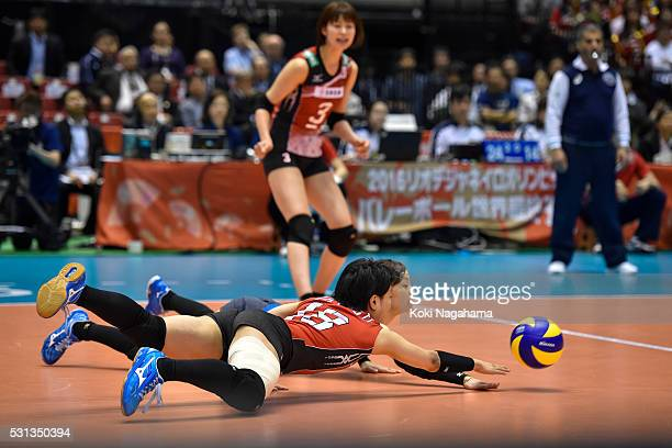 Arisa Sato and Kotoki Zayasu receive the ball during after the Women's World Olympic Qualification game between Japan and Peru at Tokyo Metropolitan...