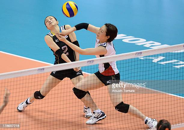 Arisa Sato and Naoko Hashimoto of Japan in action during day three of the FIVB World Grand Prix Sapporo 2013 match between Serbia and Japan at...