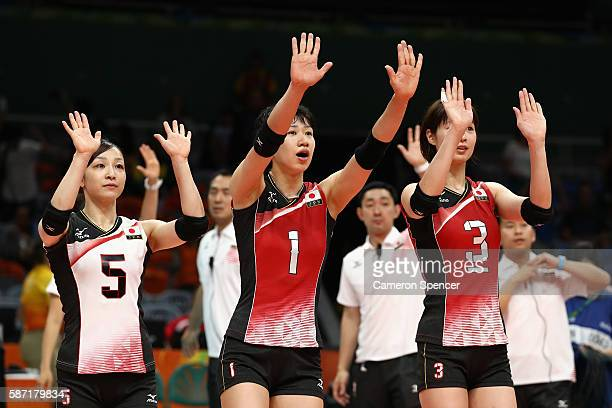 Arisa Sato Miyu Nagaoka and Saori Kimura of Japan thank the crowd after winning the Women's Preliminary Pool A match between Japan and Cameroon on...