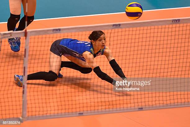 Arisa Sato of Japan receives the ball duribg the Women's World Olympic Qualification game between Japan and Peru at Tokyo Metropolitan Gymnasium on...