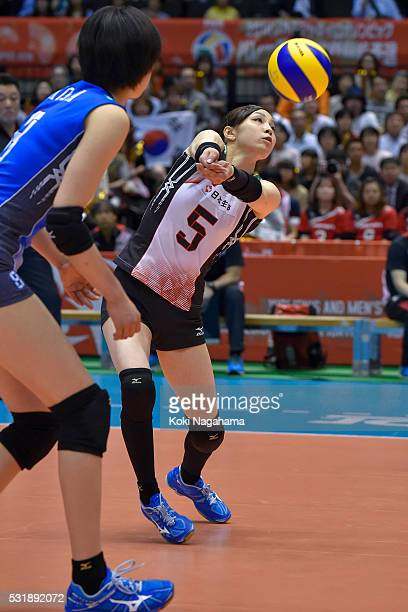 Arisa Sato of Japan receives the ball during the Women's World Olympic Qualification game between South Korea and Japan at Tokyo Metropolitan...