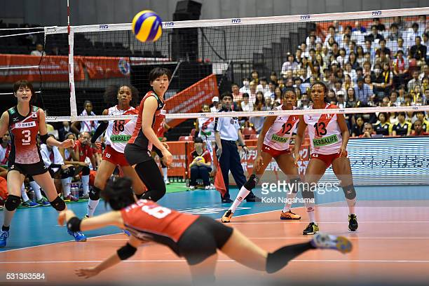 Arisa Sato of Japan recieves the ball during the Women's World Olympic Qualification game between Japan and Peru at Tokyo Metropolitan Gymnasium on...