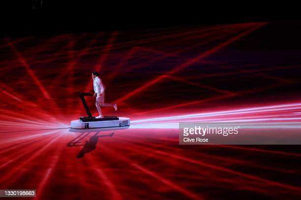 Arisa Tsubata runs on a treadmill during the Opening Ceremony of the Tokyo 2020 Olympic Games at Olympic Stadium on July 23, 2021 in Tokyo, Japan.