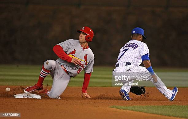 Arismendy Alcantara of the Chicago Cubs misses the throw allowing Peter Bourjos of the St Louis Cardinals to steal second base in the 9th inning...