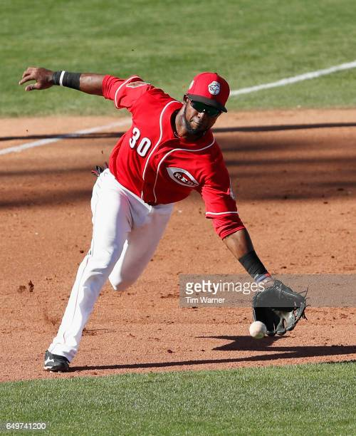 Arismendy Alcantara of the Cincinnati Reds fields a ground ball in the ninth inning against the Los Angeles Angels during the spring training game at...