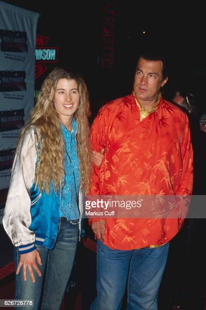Arissa Wolf and Steven Seagal arrives at the Hard Rock Cafe at CityWalk at Universal Studios Hollywood for a Charity Jam