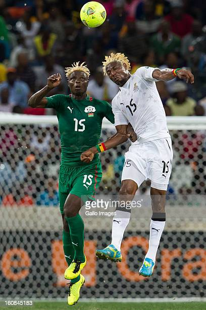 Aristide Bance from Burkina Faso and Isaac Vorsah from Ghana compete for the ball during the 2013 Orange African Cup of Nations 2nd Semi Final match...