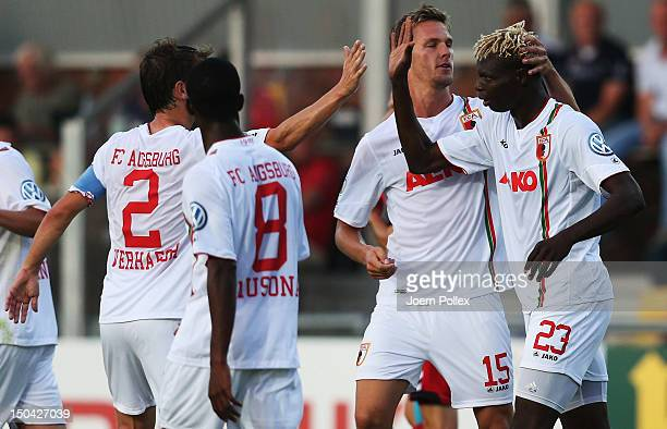 Aristide Bance of Augsburg celebrates with his team mates after scoring his team's first goal during the DFB Cup first round match between SV...