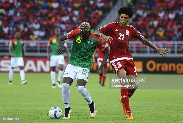 Aristide Bance of Burkina Faso in action against Carlos Mosibe of Equatorial Guinea at Bata stadium ahead of the 2015 African Cup of Nations football...
