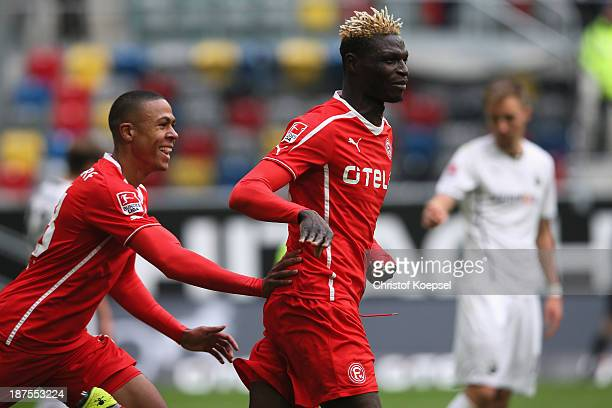 Aristide Bance of Duesseldorf celebrates the first goal with Mathis Bolly of Duesseldorf during the Second Bundesliga match between Fortuna...