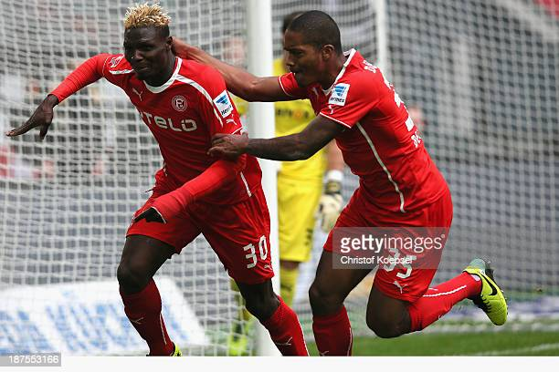 Aristide Bance of Duesseldorf celebrates the first goal with Charlison Benschop of Duesseldorf during the Second Bundesliga match between Fortuna...
