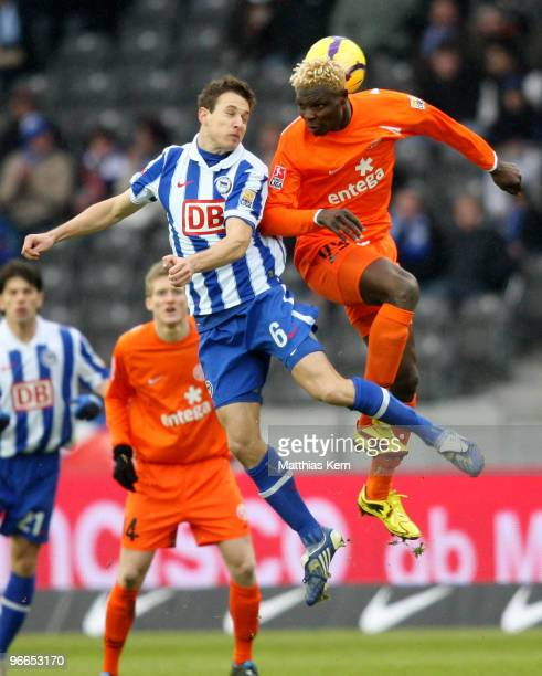 Aristide Bance of Mainz and Christoph Janker of Berlin jump for a header during the Bundesliga match between Hertha BSC Berlin and FSV Mainz 05 at...