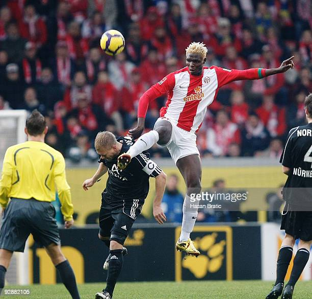 Aristide Bance of Mainz battles for the ball with Andreas Wolf of Nuernberg during the Bundesliga match between FSV Mainz 05 and 1 FC Nuernberg at...