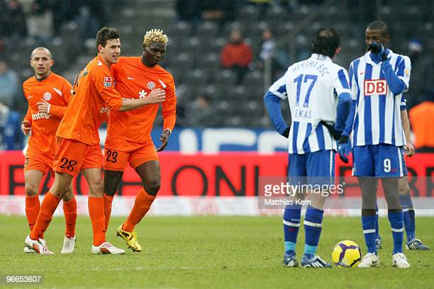 Aristide Bance of Mainz jubilates with team mate Adam Szalai after scoring the first goal during the Bundesliga match between Hertha BSC Berlin and...