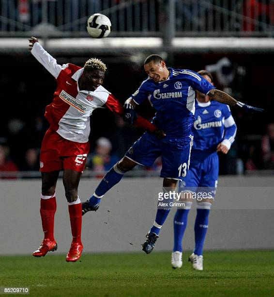 Aristide Bance of Mainz jumps for the ball with Jermaine Jones of Schalke during the DFB Cup quarter final match between FSV Mainz 05 and FC Schalke...