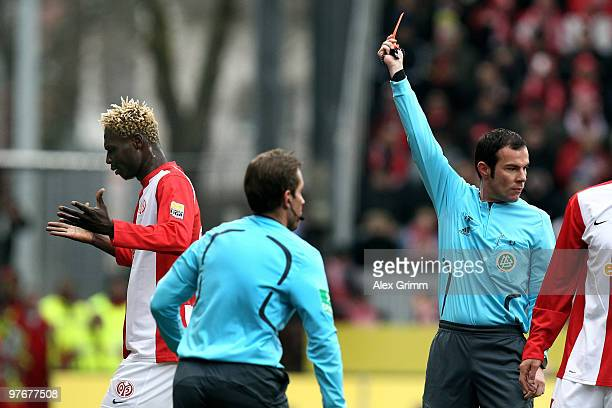 Aristide Bance of Mainz leaves the pitch after been sent off and booked red card by referee Marco Fritz during the Bundesliga match between FSV Mainz...