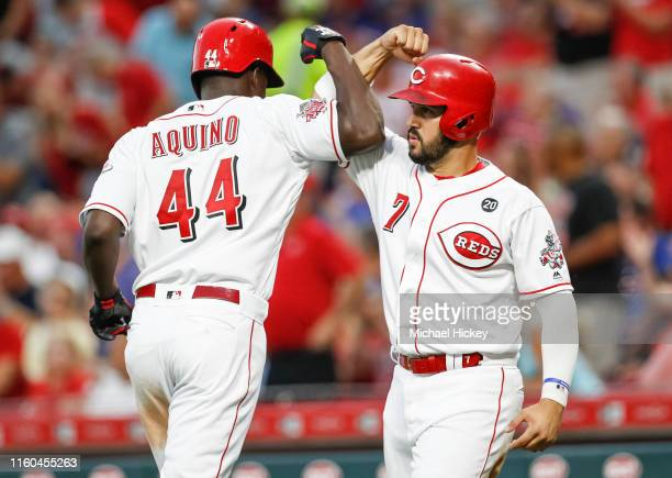 Aristides Aquino and Eugenio Suarez of the Cincinnati Reds celebrate during the game against the Chicago Cubs at Great American Ball Park on August 8...