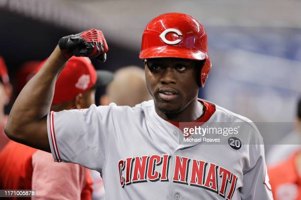 Aristides Aquino of the Cincinnati Reds celebrates after hitting a two-run home run against the Miami Marlins during the first inning at Marlins Park...