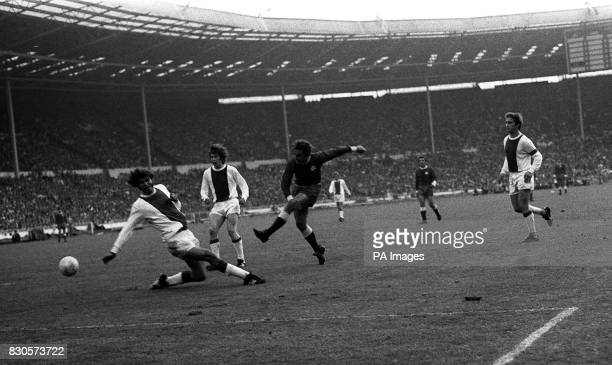 Aristidis Kamaras right of Panathinaikos pushes the ball past Barry Hulshoff an Ajax defender during the final of the European Cup played at Wembley