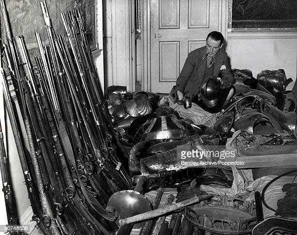 2nd May 1953 The Duke of Argyll with his collection of arms and armour at his home at Inveraray Castle