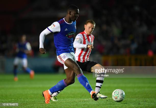 Aristote Nsiala of Ipswich Town holds off Matt Jay of Exeter City during the Carabao Cup First Round match between Exeter City and Ipswich Town at St...