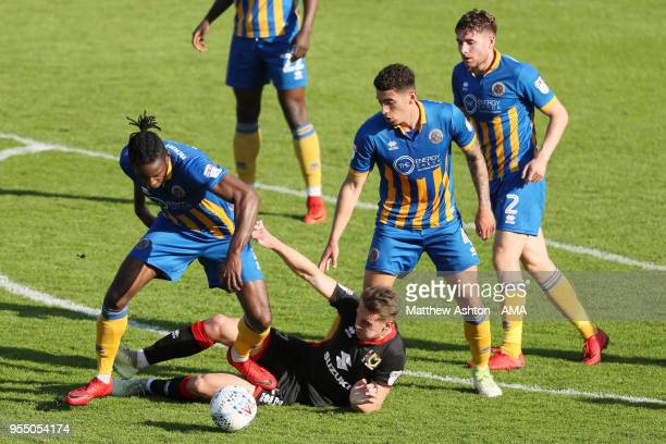 Aristote Nsiala of Shrewsbury Town and Callum Brittain of MK Dons during the Sky Bet League One match between Shrewsbury Town and Milton Keynes Dons...