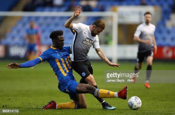 Aristote Nsiala of Shrewsbury Town and Danny Lloyd of Peterborough United during the Sky Bet League One match between Shrewsbury Town and...
