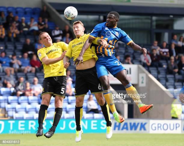 Aristote Nsiala of Shrewsbury Town and Kyle McFadzean and Jake Buxton of Burton Albion during the PreSeason Friendly between Shrewsbury Town and...