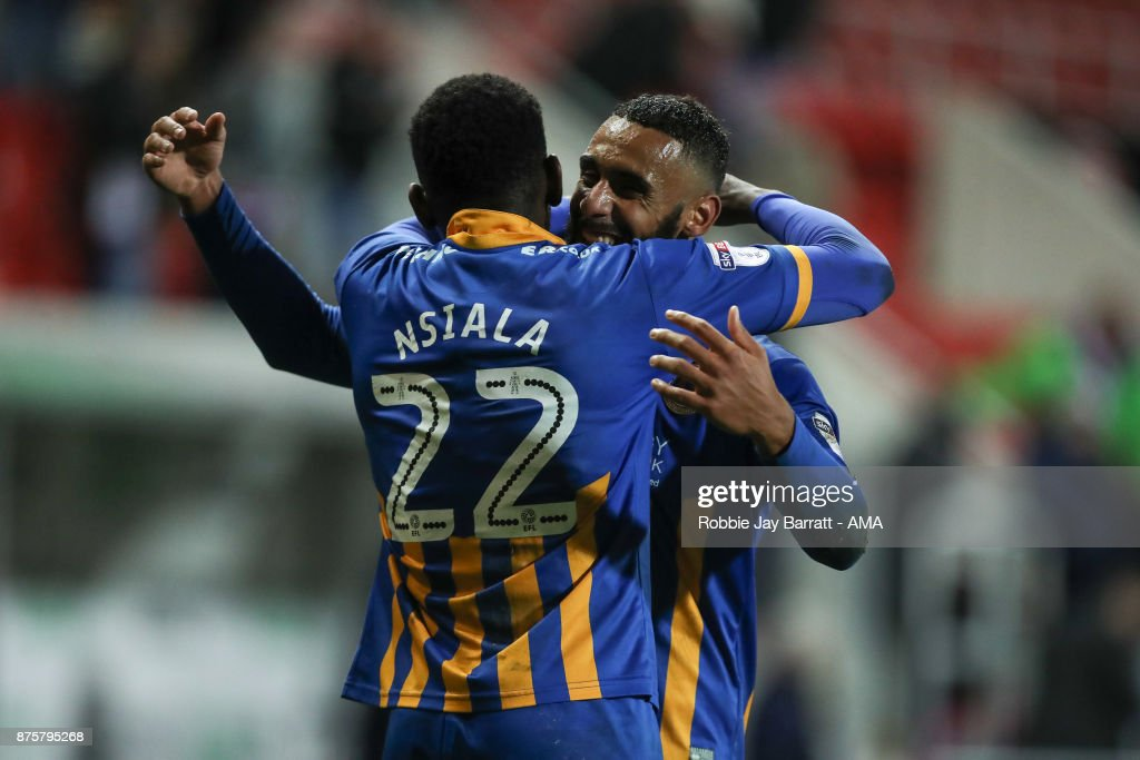 Aristote Nsiala of Shrewsbury Town and Stefan Payne of Shrewsbury Town celebrate at full time during the Sky Bet League One match between Rotherham United and Shrewsbury Town at The New York Stadium on November 16, 2017 in Rotherham, England.