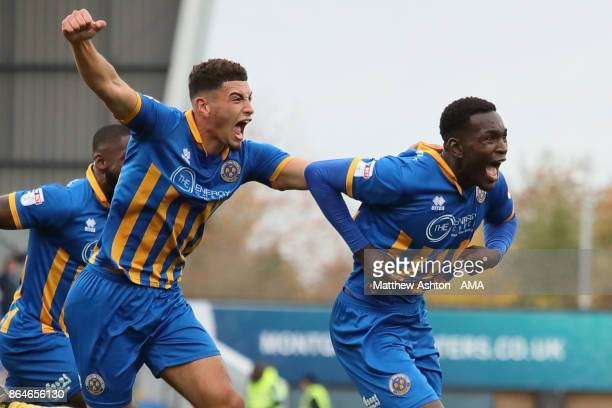 Aristote Nsiala of Shrewsbury Town celebrates after scoring a goal to make it 10 during the Sky Bet League One match between Shrewsbury Town and...
