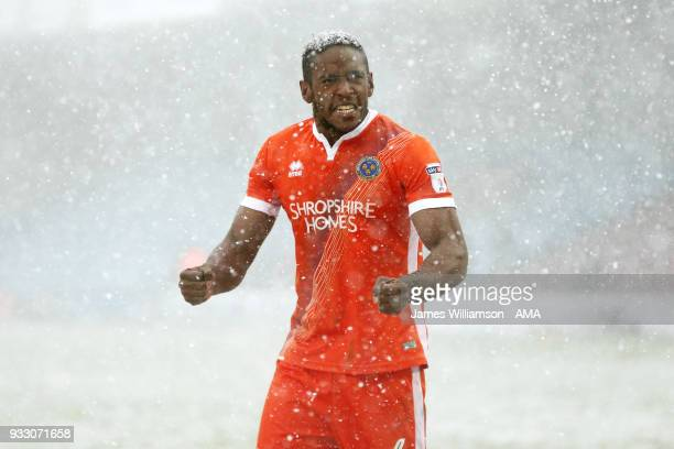 Aristote Nsiala of Shrewsbury Town celebrates victory during the Sky Bet League One match between Scunthorpe United and Shrewsbury Town at Glanford...